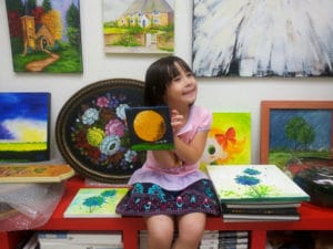art classes singapore - little girl with small painted canvas