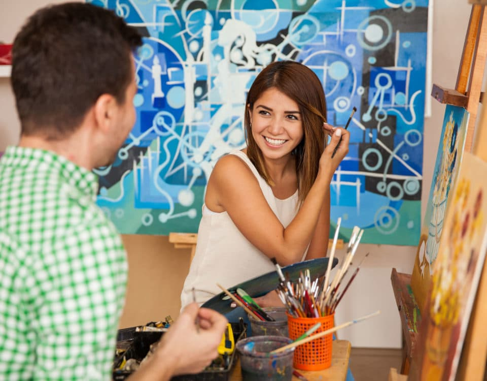Couple painting on canvas together